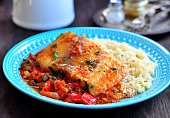 White sea fish cooked in a spicy tomato sauce