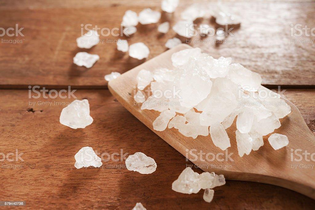 White sea salt on wooden ladle stock photo