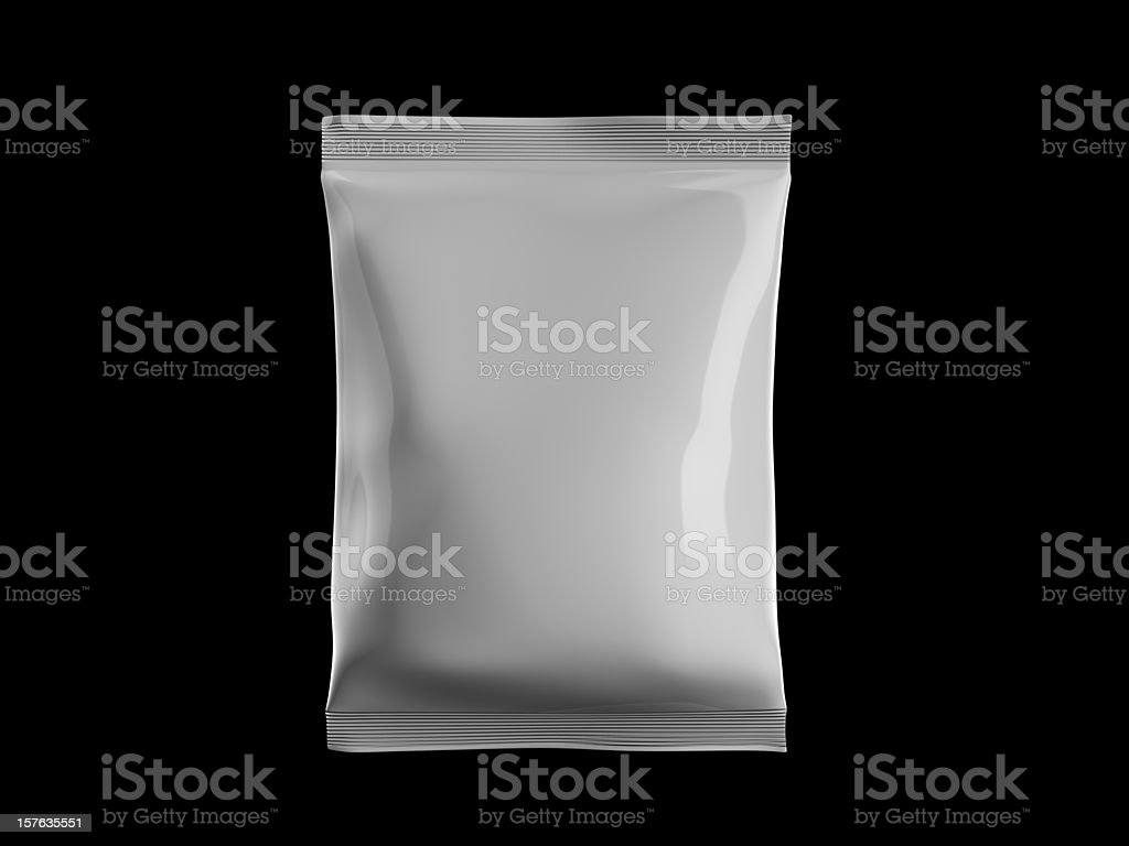 White sealed bag of candy on black background stock photo