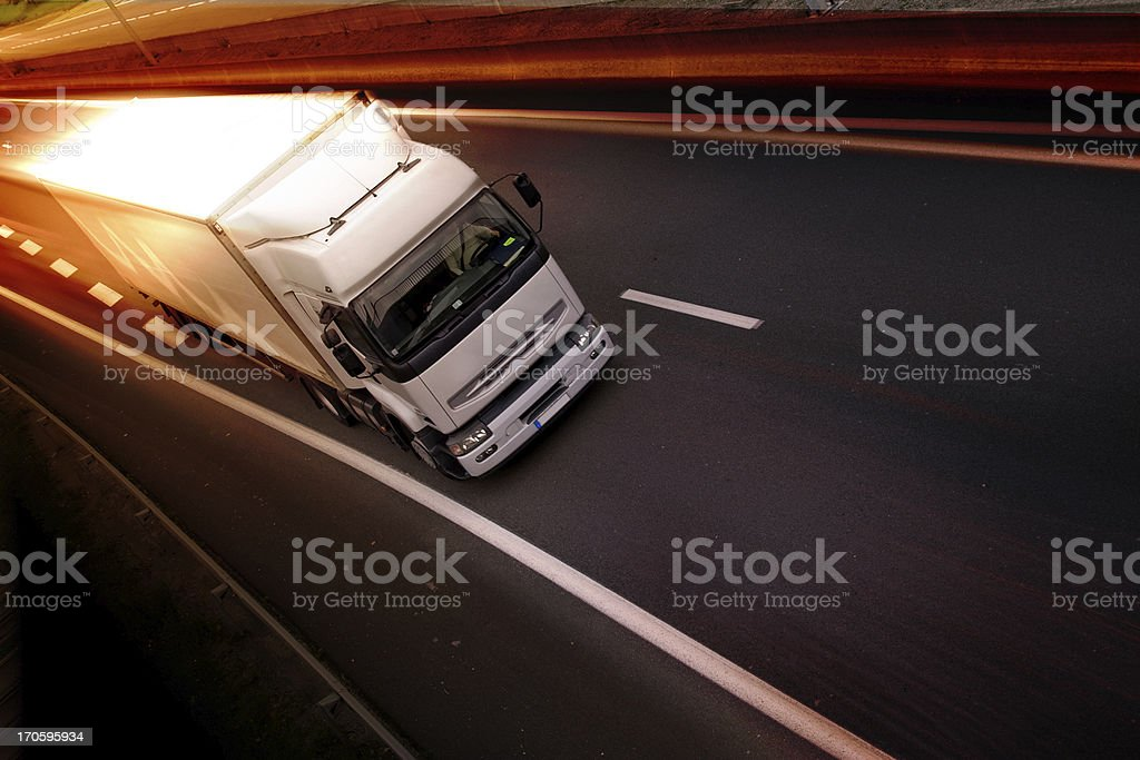 White semi truck on a highway in blurred motion stock photo