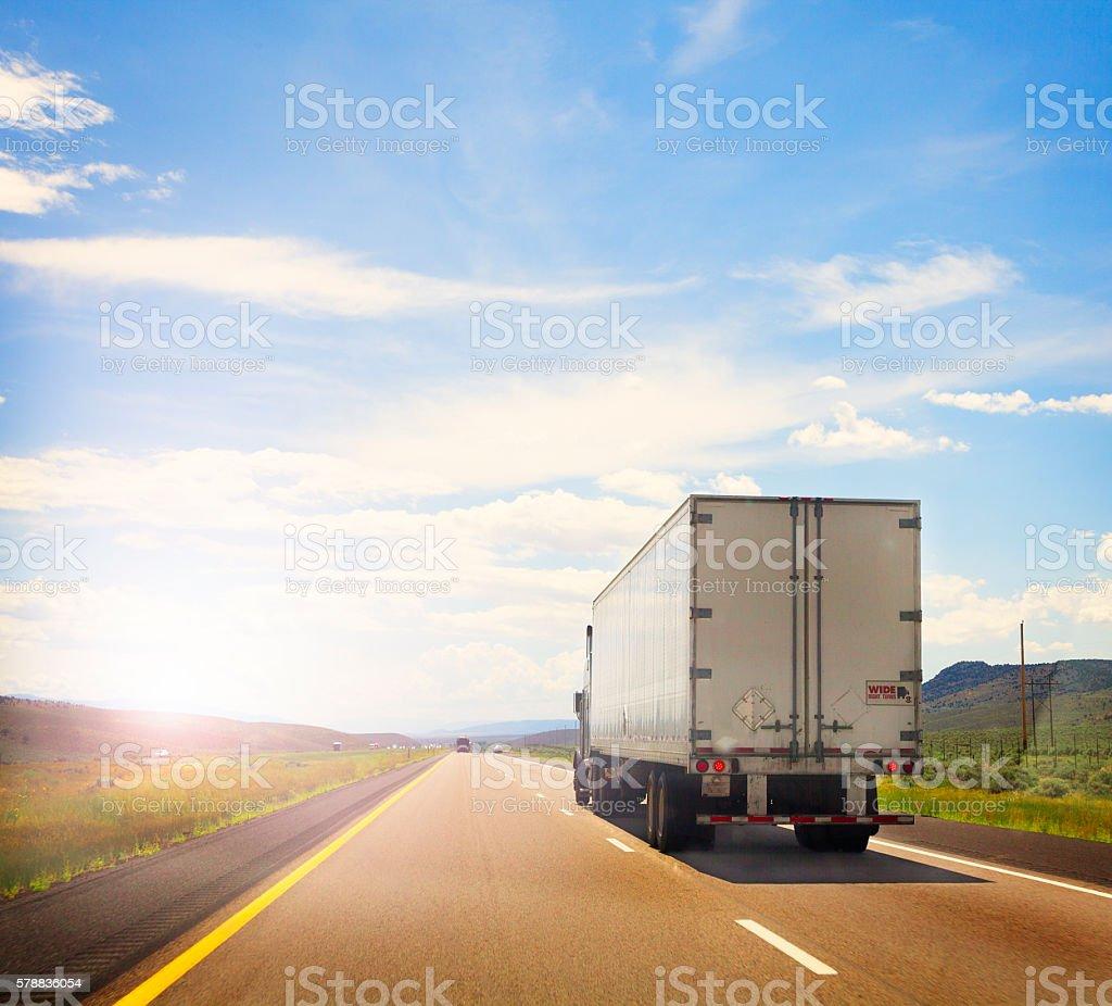 White Semi Truck on the road stock photo
