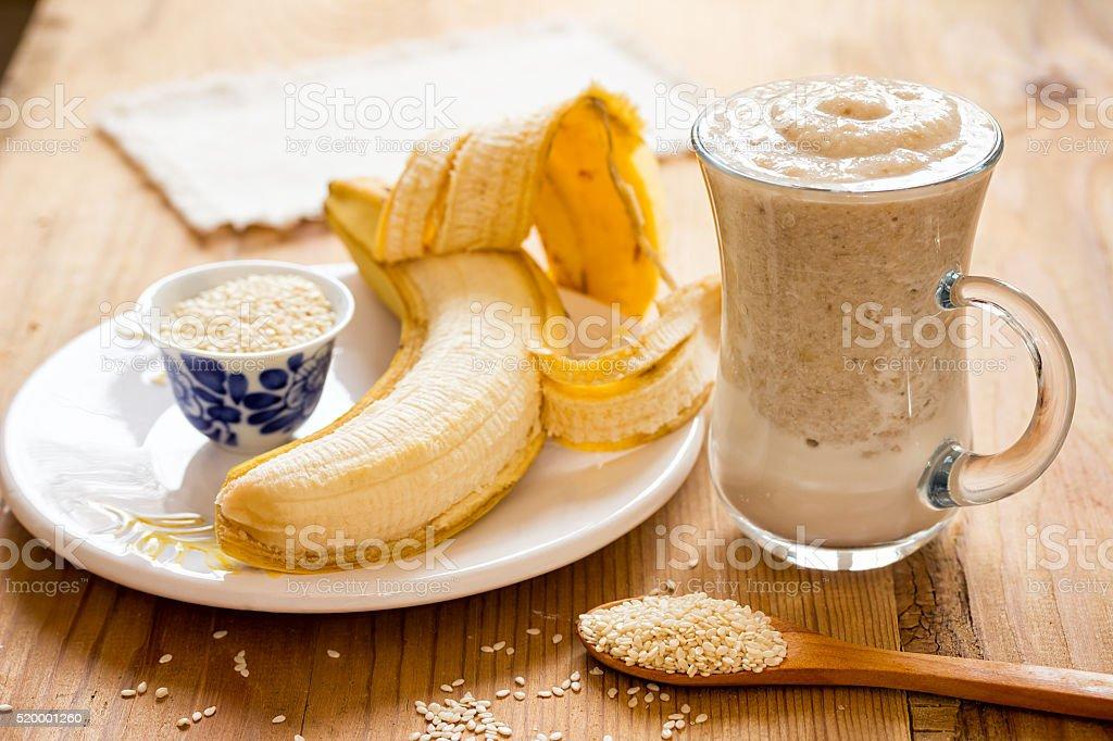 White sesame milk and a banana smoothie. stock photo