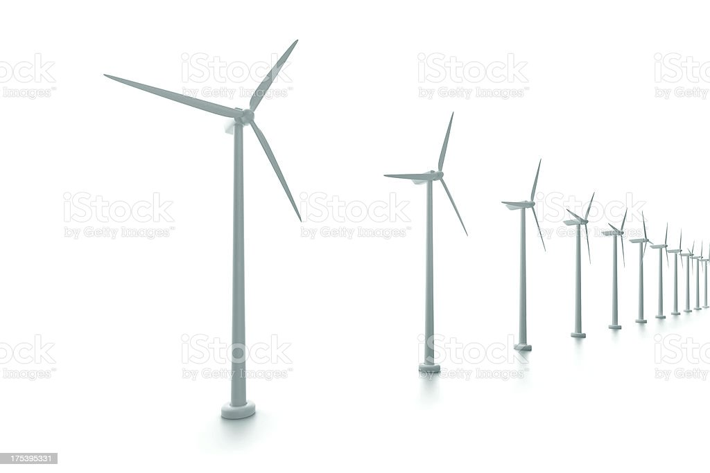 White shaded wind turbines in a line stock photo