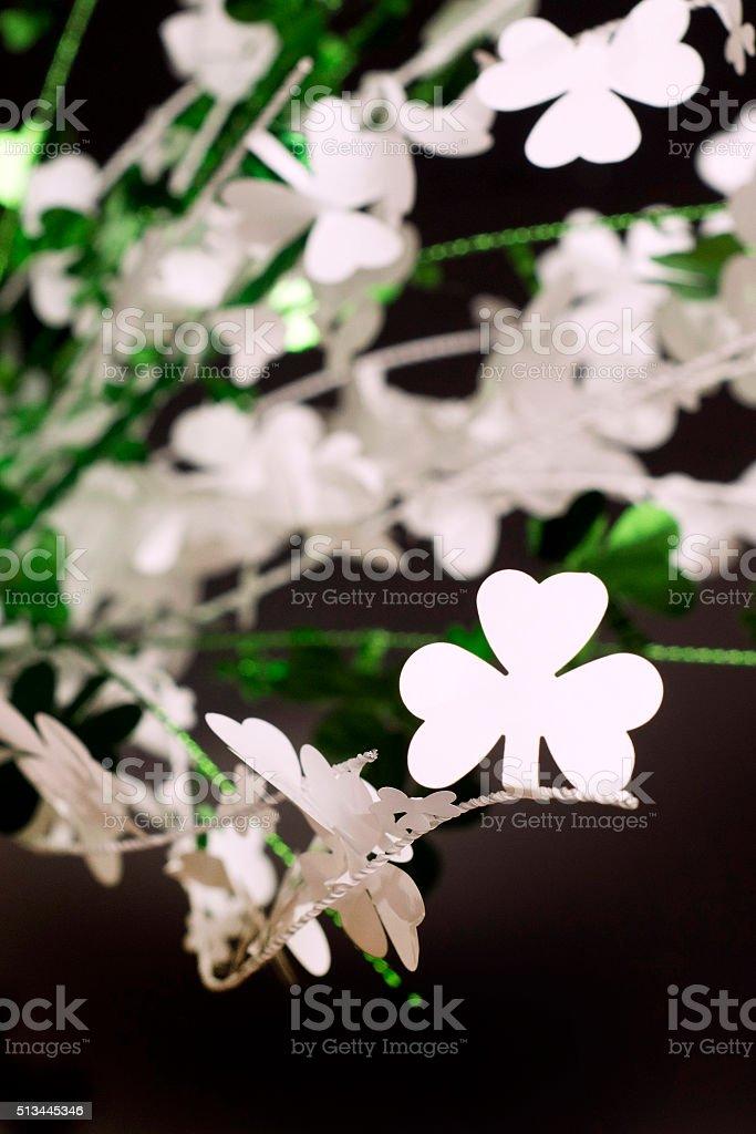 white shamrock on black and green background stock photo