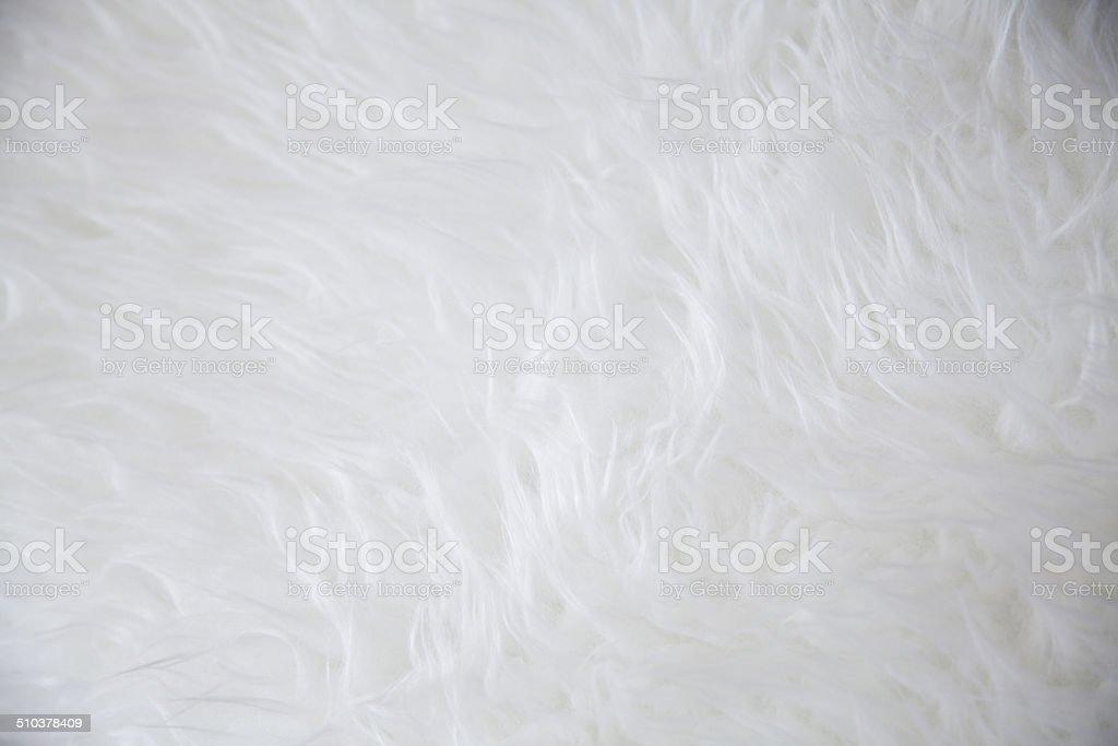 white sheepskin rug texture stock photo