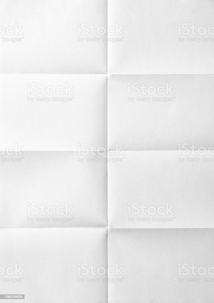 white sheet of paper folded stock photo
