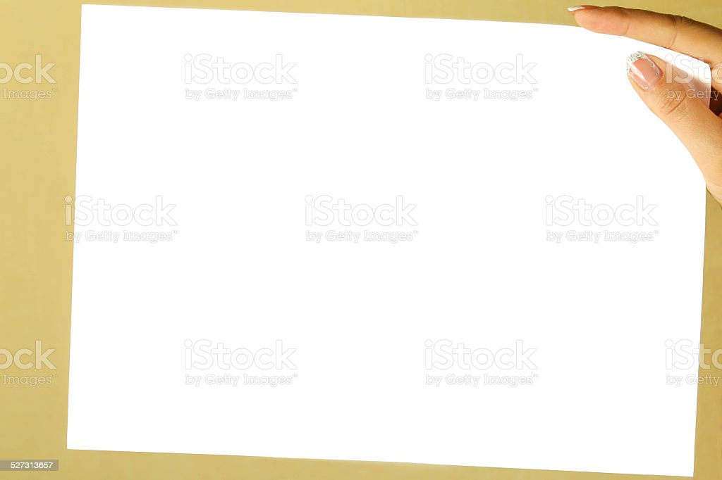 white sheet of paper in a female hand stock photo