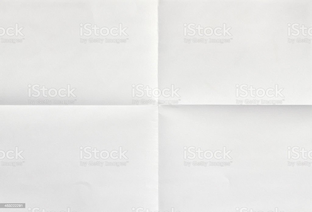 White sheet of paper in four stock photo