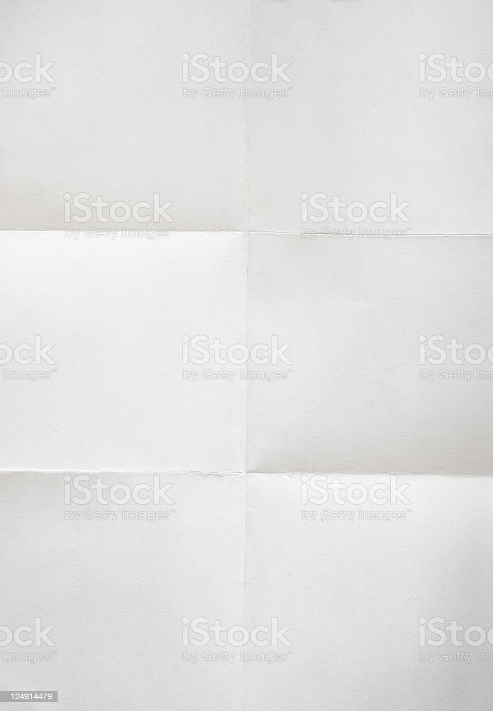White sheet of paper with folded squared lines stock photo