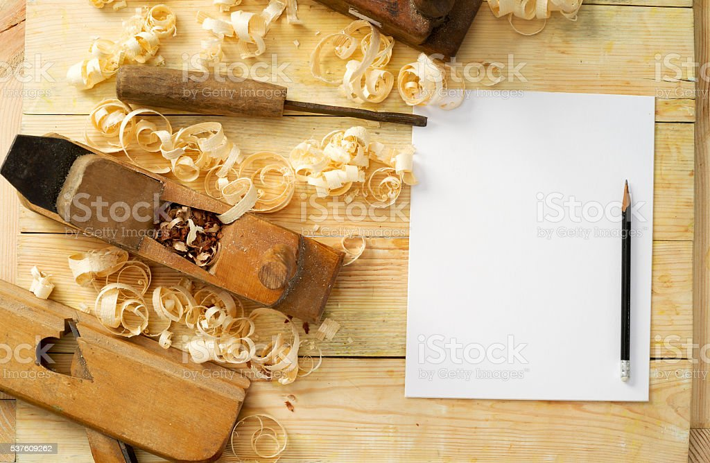 White sheet on wooden table for carpenter tools with sawdust. stock photo