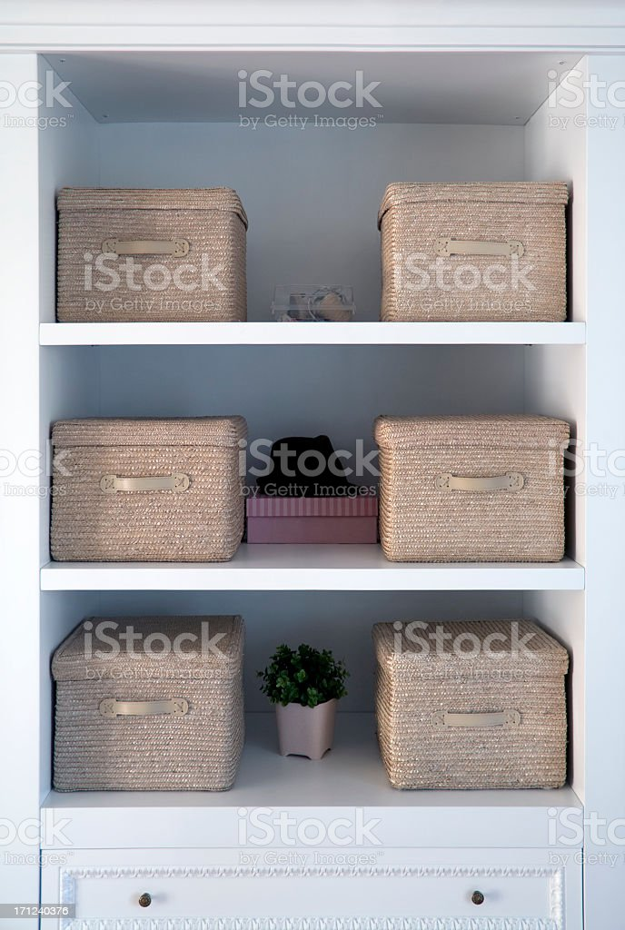 White shelved with tan boxes atop them stock photo
