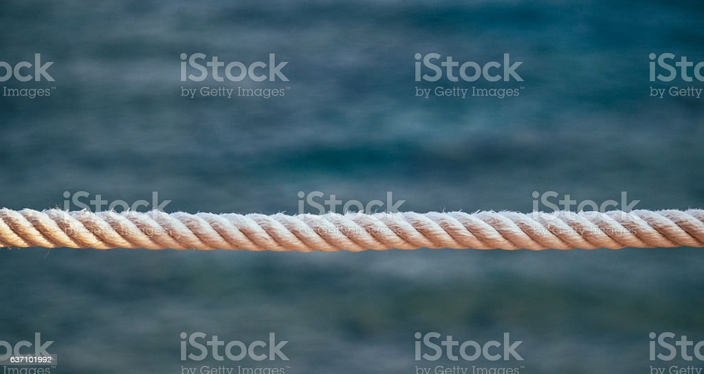 White ship rope and the sea stock photo