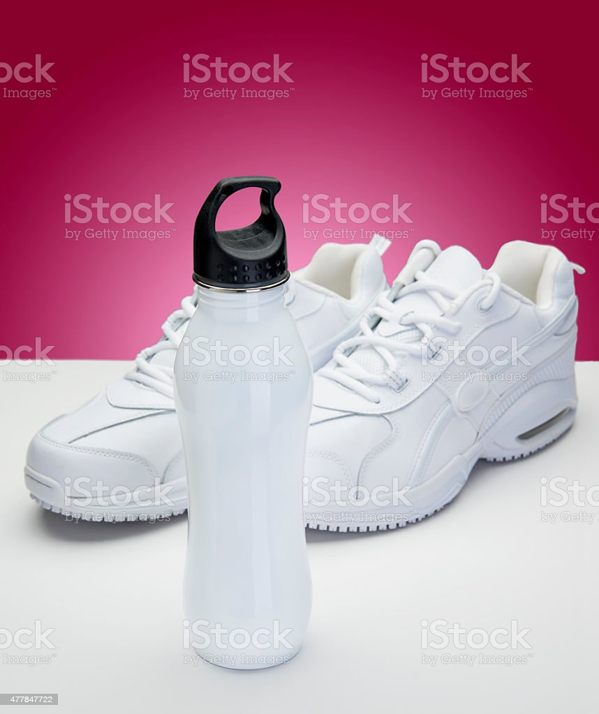 White Shoes and Water Bottle stock photo