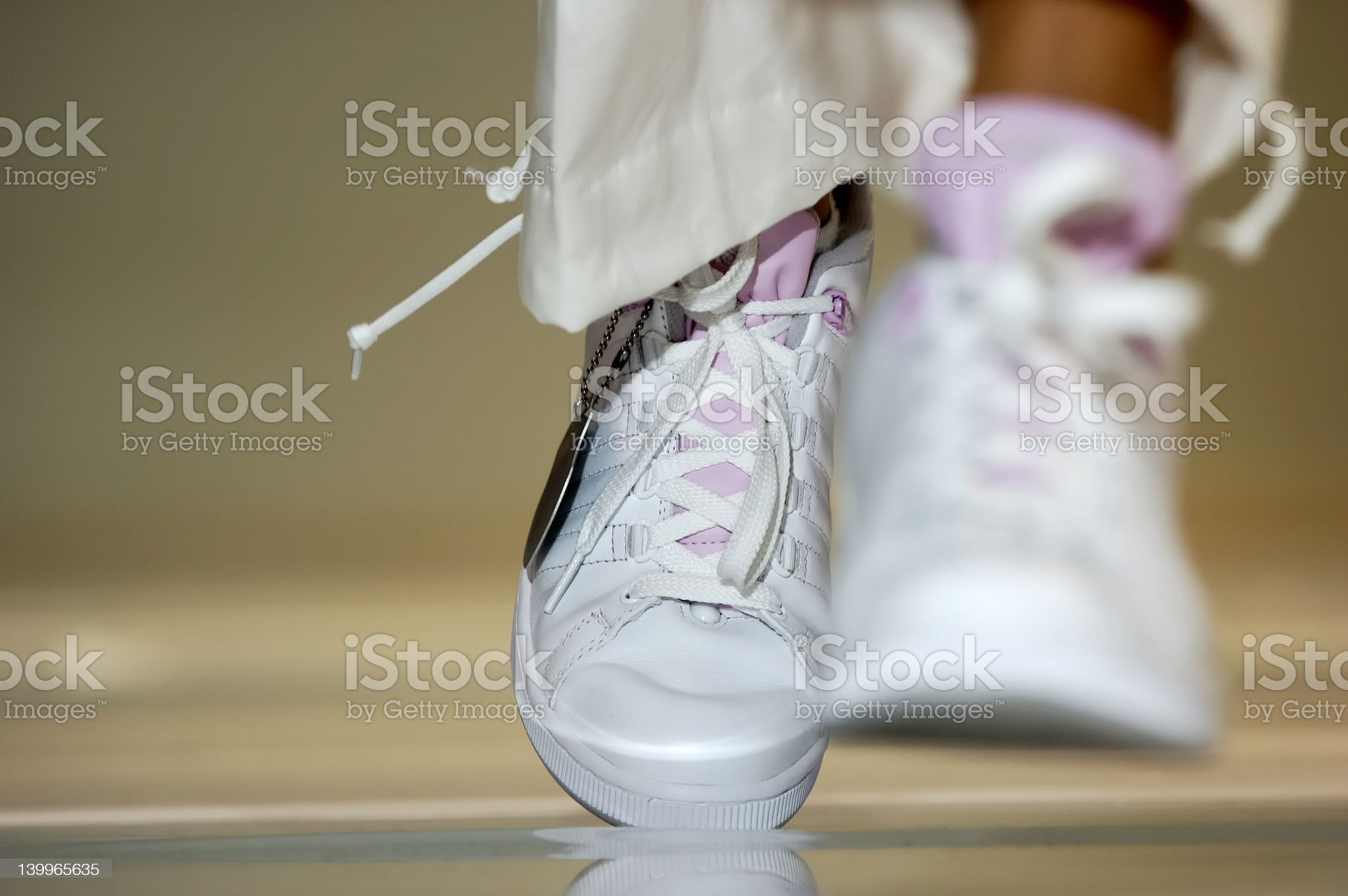 White shoes (sneakers) in motion (walking) royalty-free stock photo