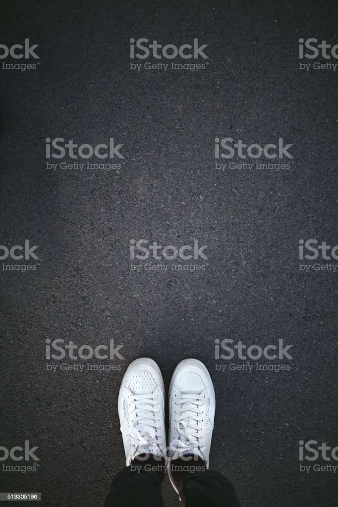 White shoes on asphalt stock photo