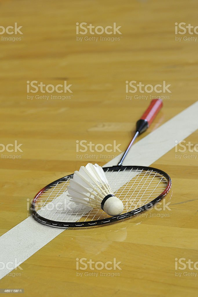 White shuttlecock lay down on racket in gymnasium royalty-free stock photo