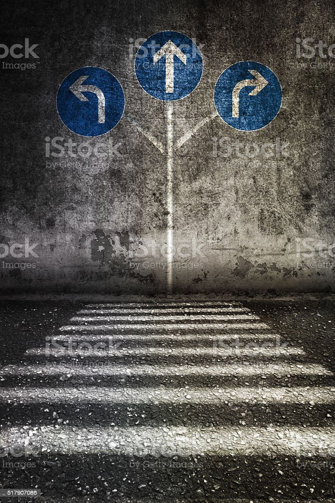 white sign way different directions at grunge wall stock photo