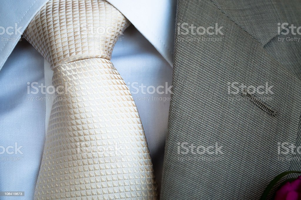 White silk tie with grey jacket lapel royalty-free stock photo