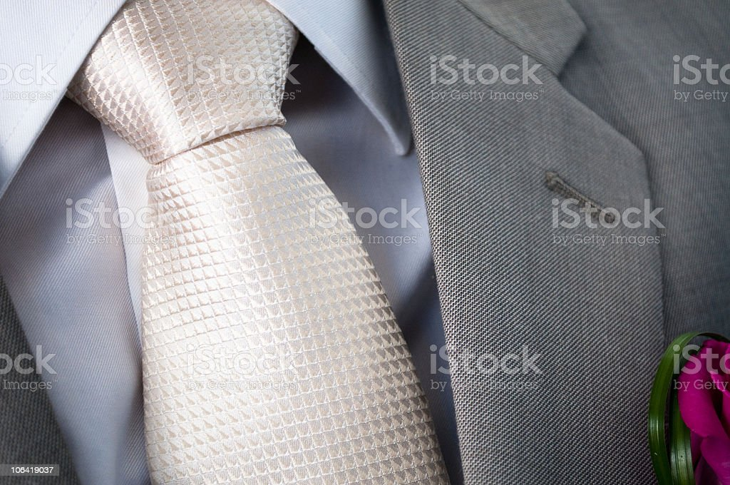 White silk tie with grey jacket lapel royalty-free stock photo