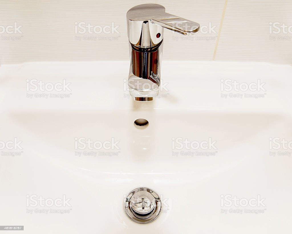 White sink and chrome faucet with handle stock photo