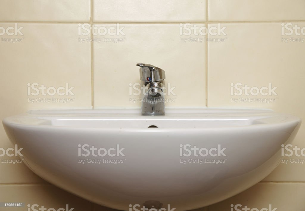 White sink and tap in the bathroom royalty-free stock photo