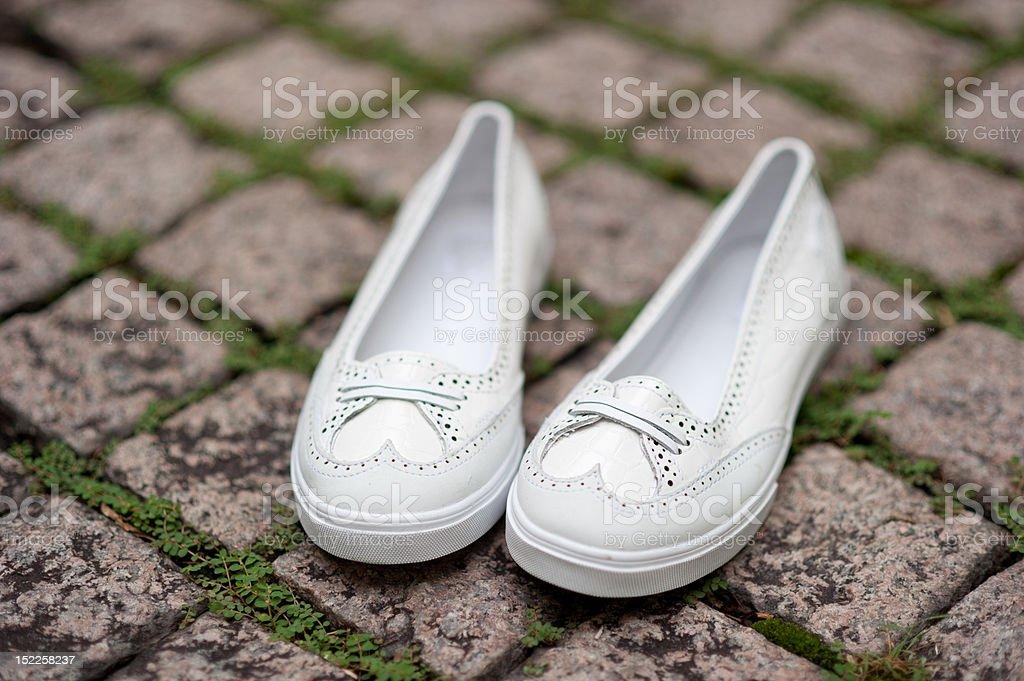 White slip on ladies shoes royalty-free stock photo