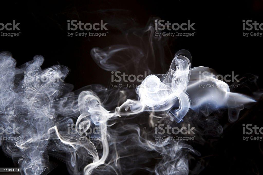 White smoke blown over a black background royalty-free stock photo