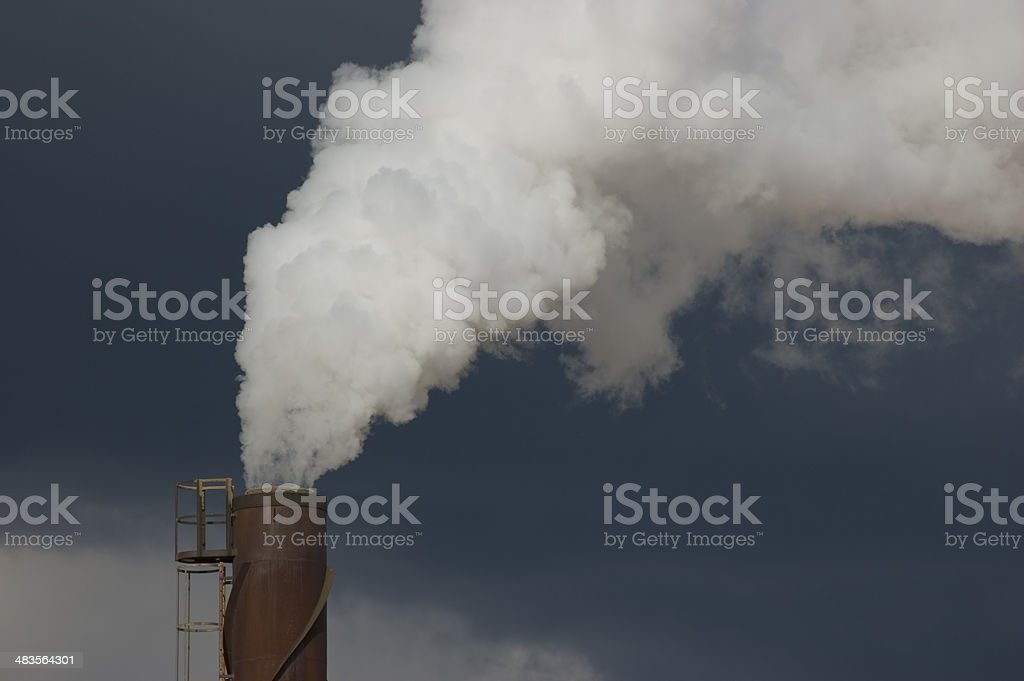 White smoke chimney, large detailed closeup, dark blue sky stock photo