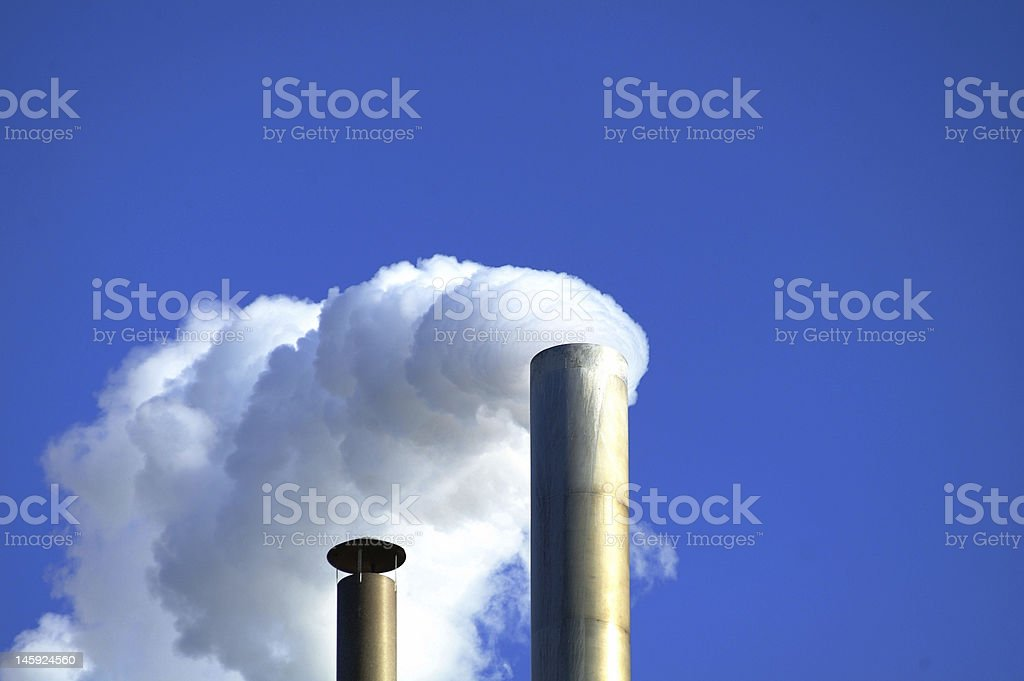 white smoke in a blue sky stock photo