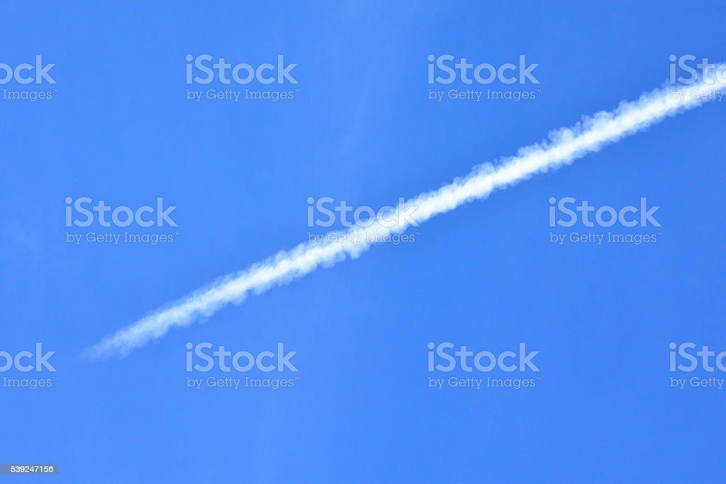 White smoke in the sky stock photo