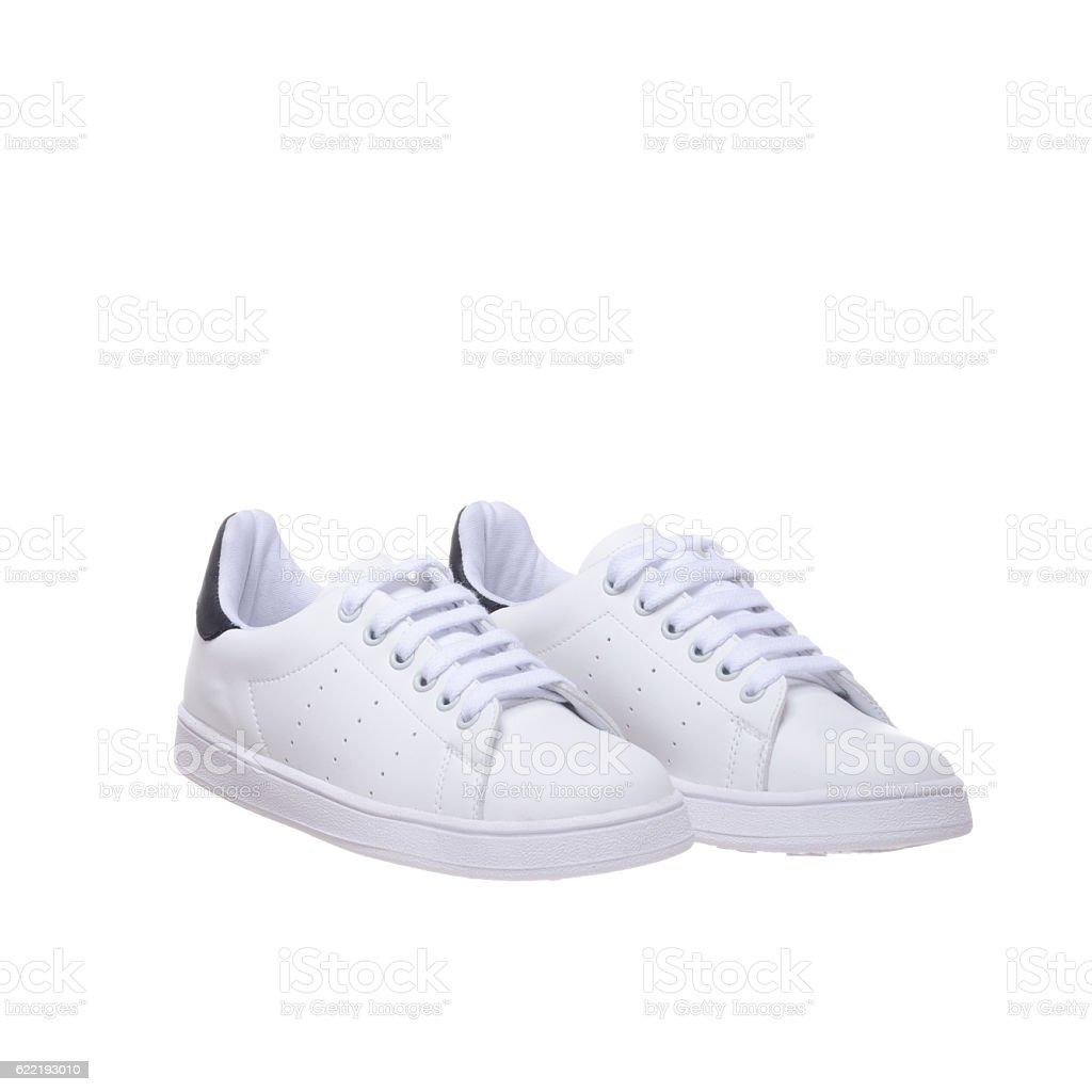 White sneakers pair stock photo