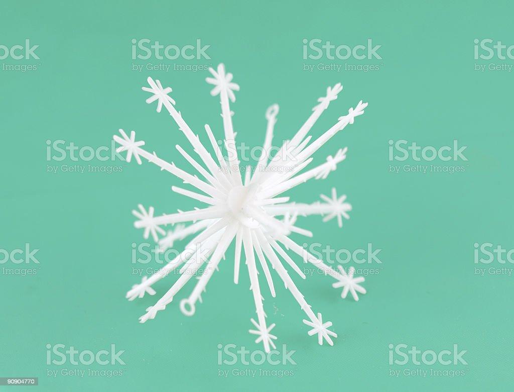 white snowflake isolated on green royalty-free stock photo