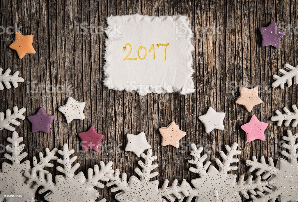 White snowflakes and colorful stars stock photo