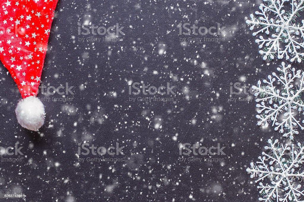 White snowflakes on a black chalkboard stock photo