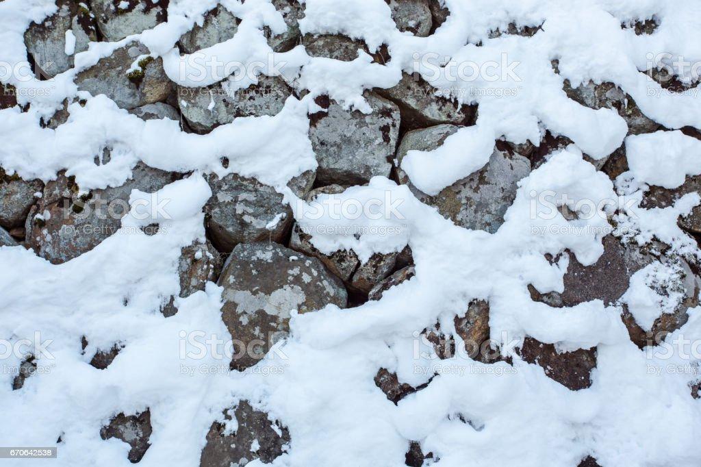 White Snowflakes On Grey Stoned Wall stock photo
