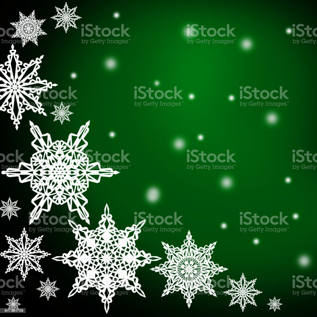 White  snowflakes,christmas pattern on the green background stock photo