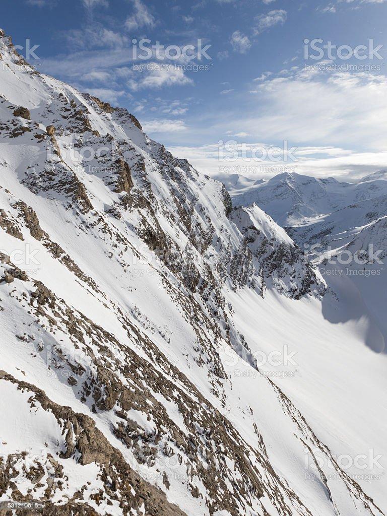 white snowy mountain peaks stock photo