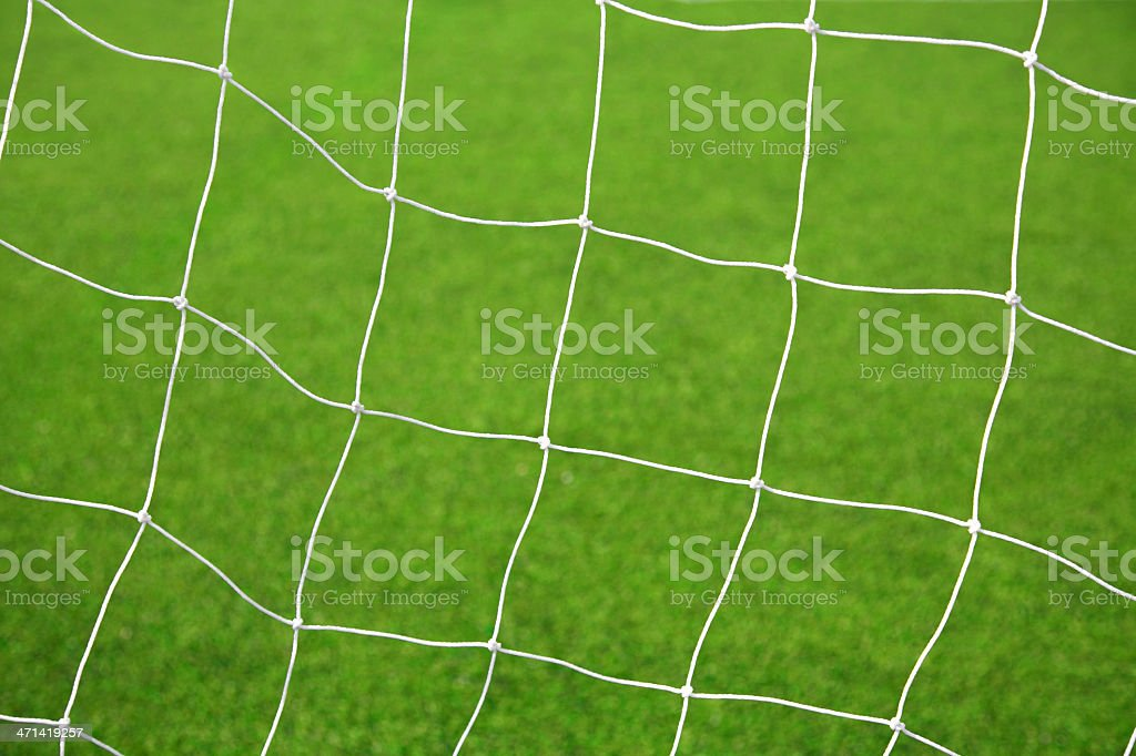 White soccer net with green grass background royalty-free stock photo