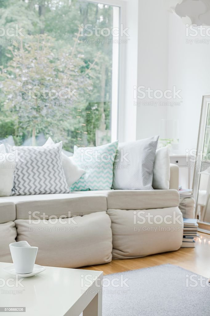 White sofa with cushions stock photo