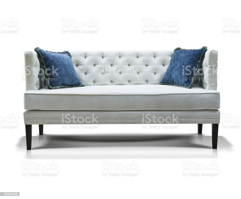 white sofa with two blue pillows  isolated stock photo