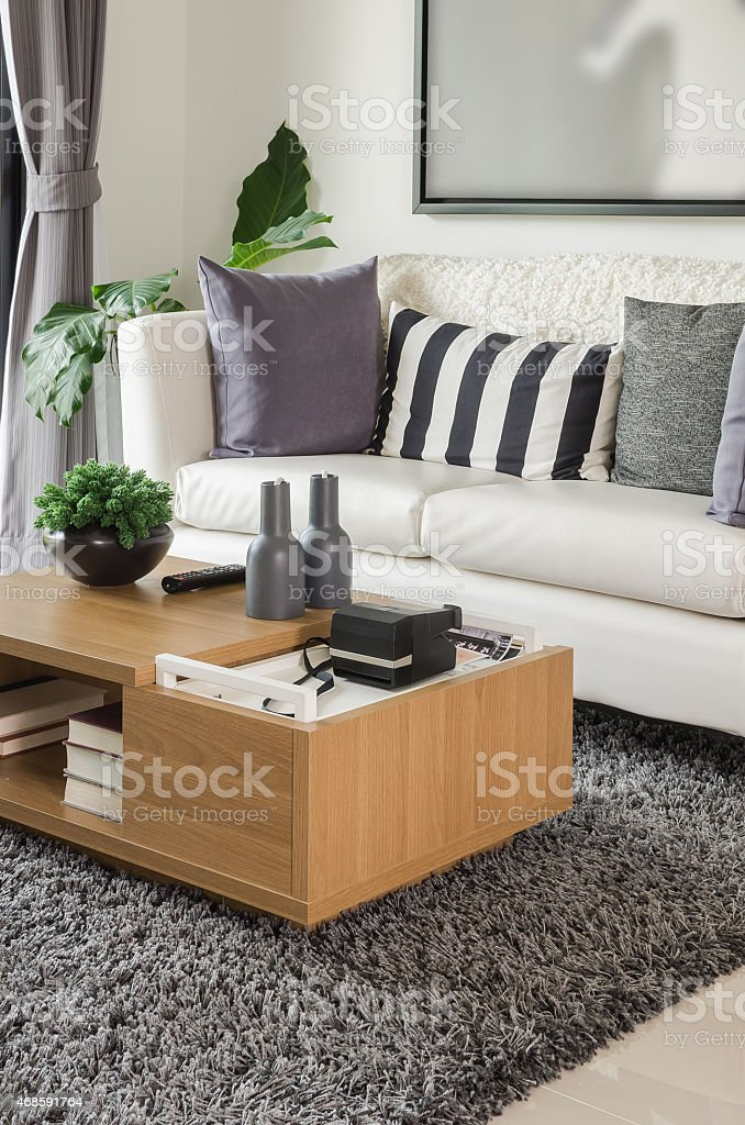 white sofa with wooden table in modern living room stock photo