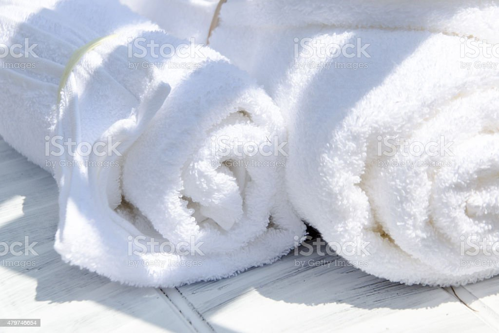 White SPA towels in a set with sunglasses stock photo