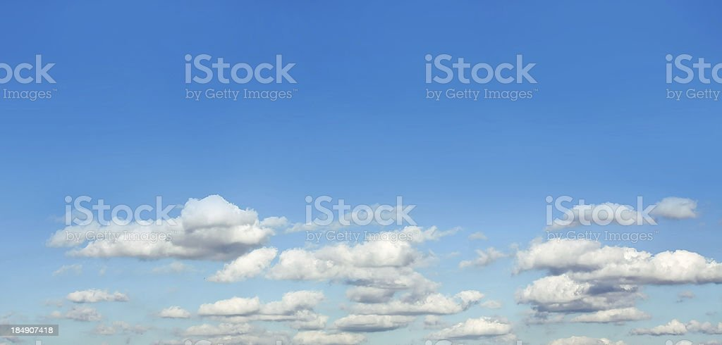 White sparse clouds over blue sky royalty-free stock photo