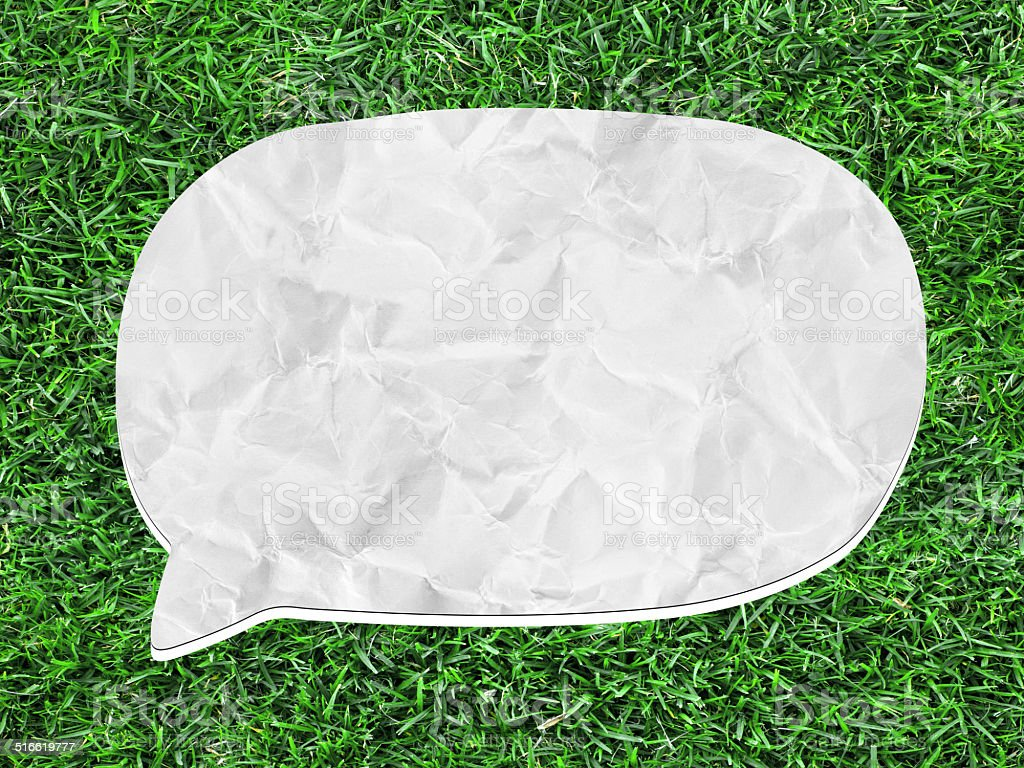 white speech bubble on green grass stock photo