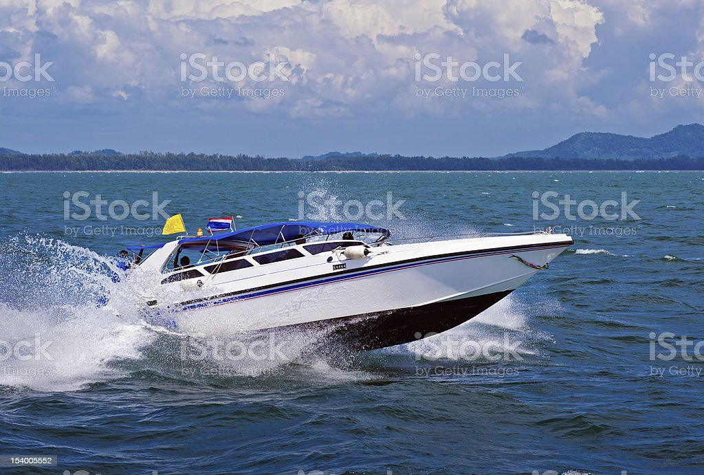 White Speedboat cruising in open sea stock photo