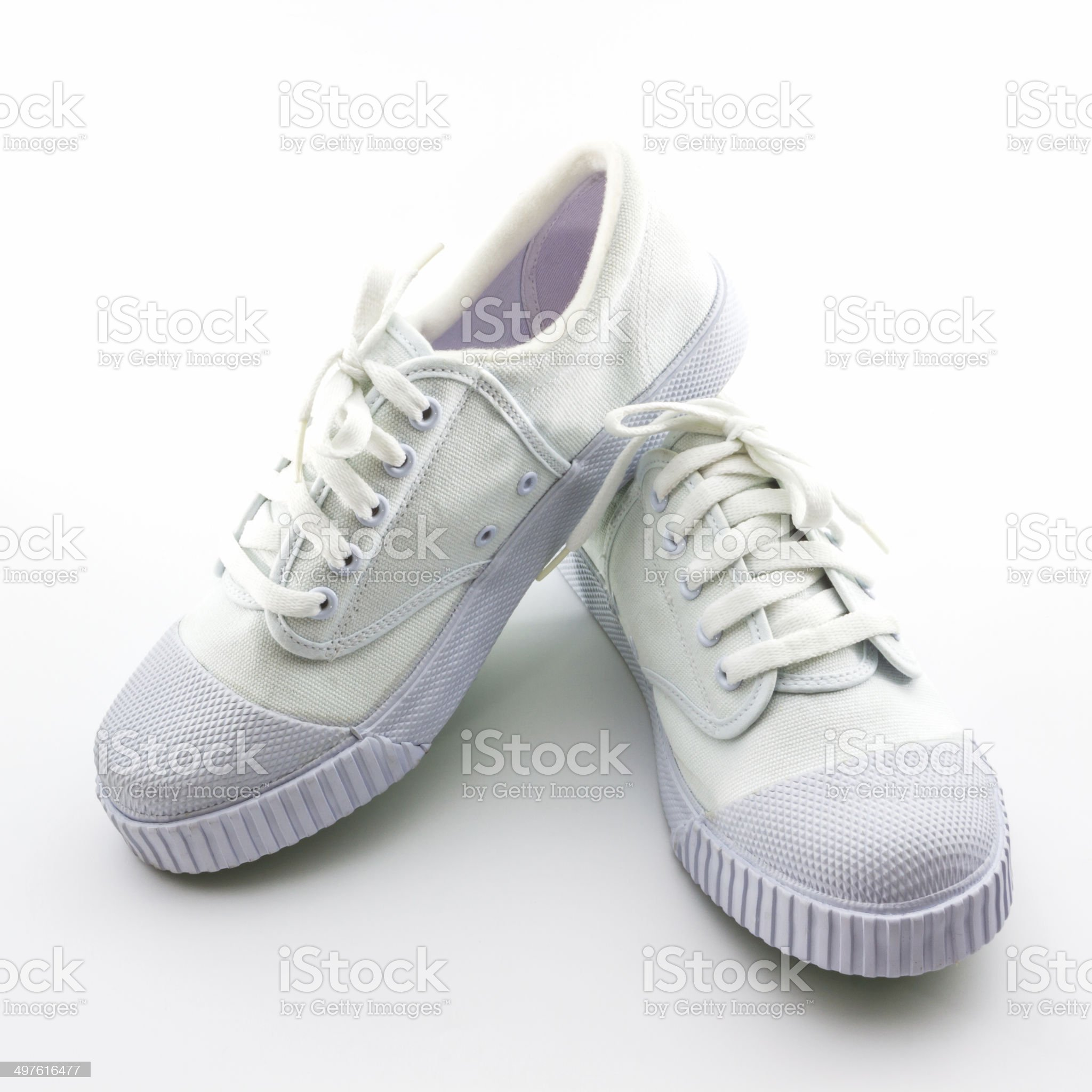 White sport shoes on white background. royalty-free stock photo