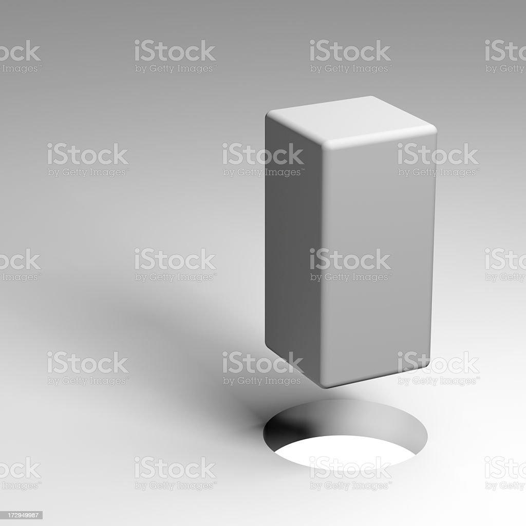 A white square peg above a circle hole royalty-free stock photo