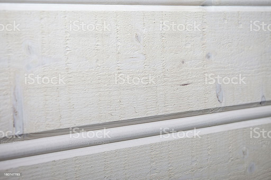 White stained plank of a wooden wall stock photo