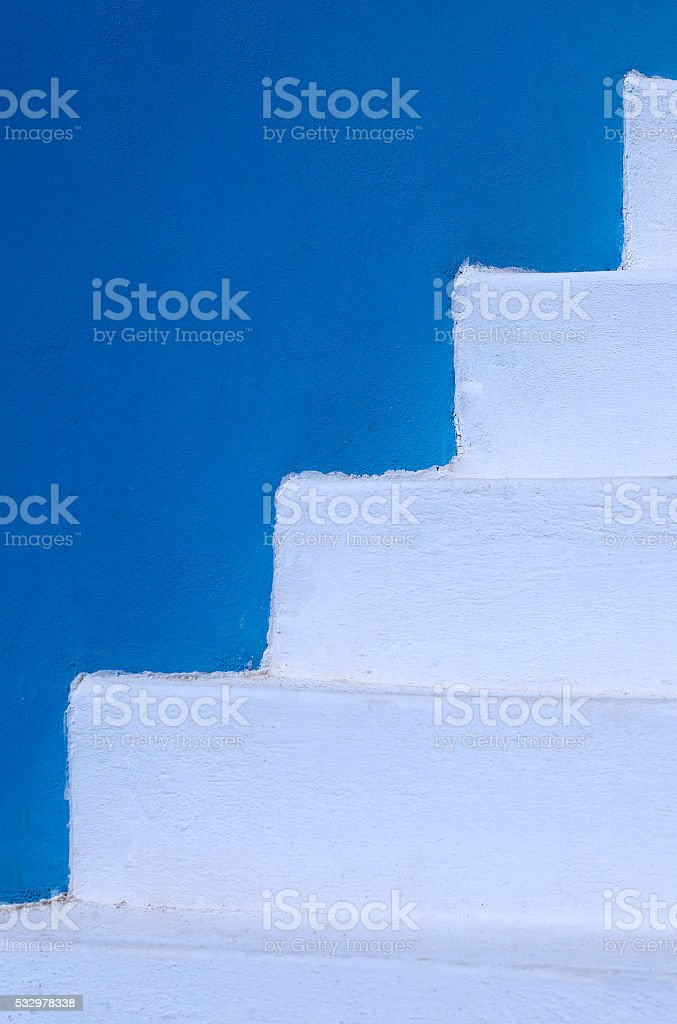 white stairs next to a blue wall royalty-free stock photo
