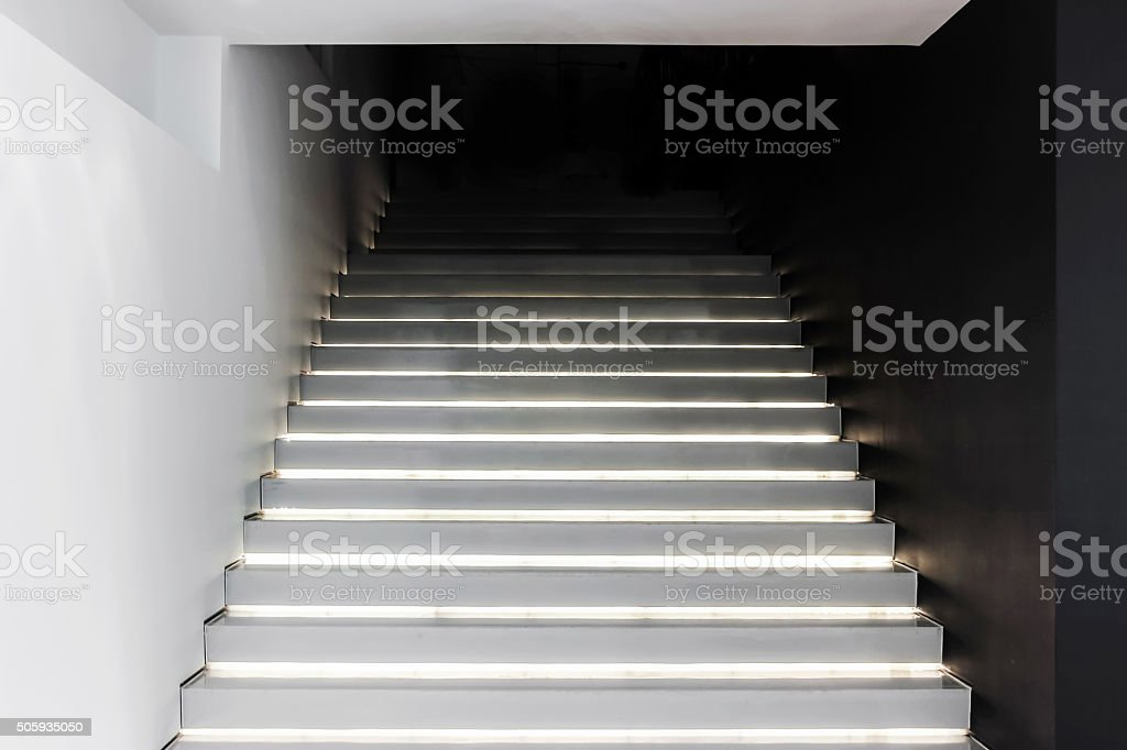 white stairs with black wall stock photo
